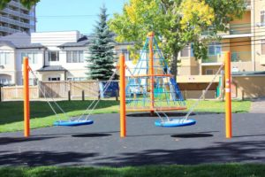 2000 days Calgary school outdoor-space with swings for children