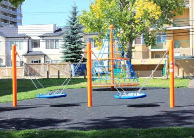2000-days-Calgary-school-outdoor-space-with-swings-for-children