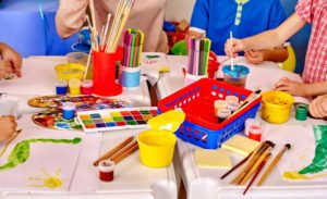 Pre-Kindergarten Group kids hands holding colored paper
