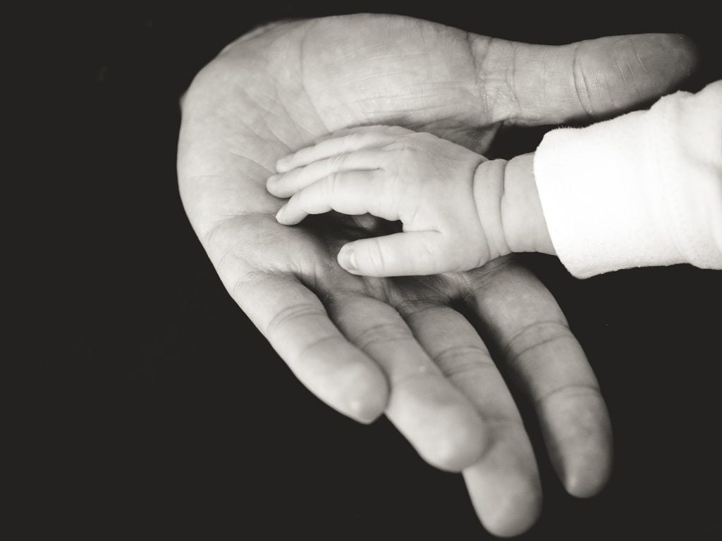 baby and nanny hands meeting together