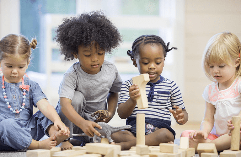3 children playing with blocks at a Calgary daycare