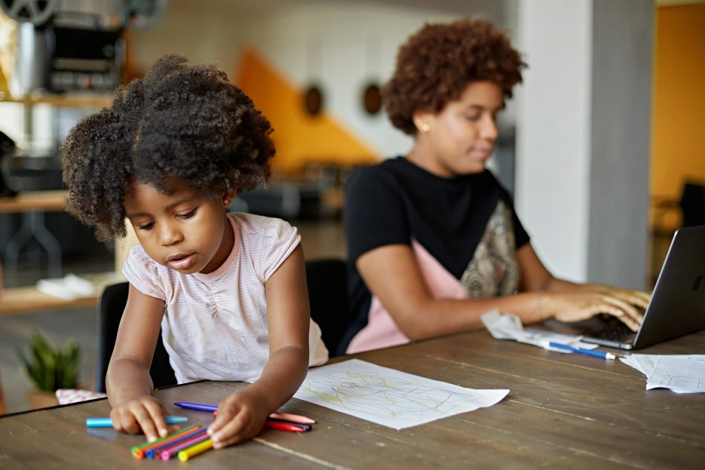 Child Drawing and Mother Working at Home in Time of COVID-19
